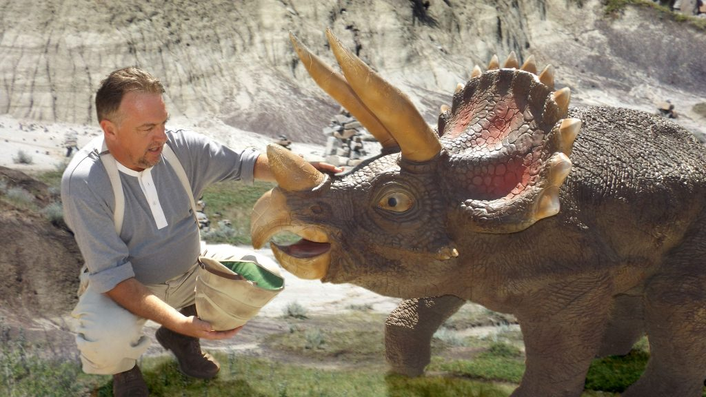 Cole befriends a young triceratops.